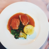 Assiette of South Down's lamb with rosemary confit potatoes, peas à la française and a lamb jus