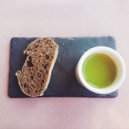English summer pea velouté with a rye bread croûte